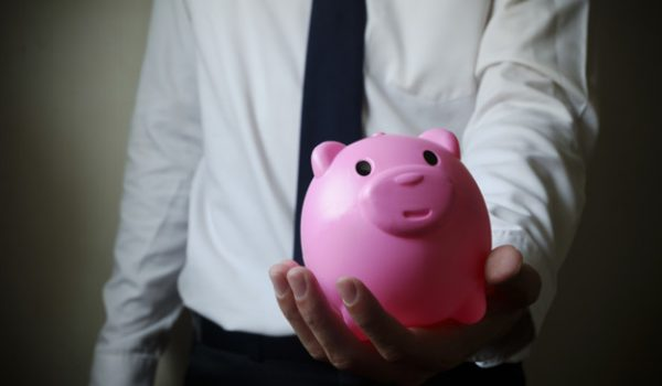 business man showing piggy bank , business finance concept